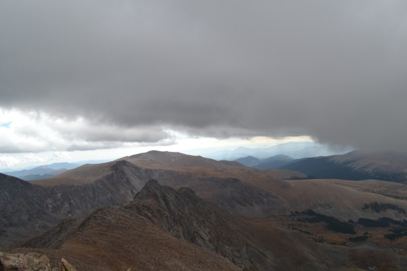 The cloud ominously comes towards us, urging us to skip lunch and get our summit photographs fast.